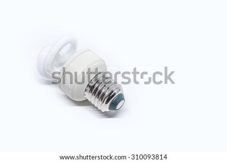 white energy saving bulb on white background - stock photo