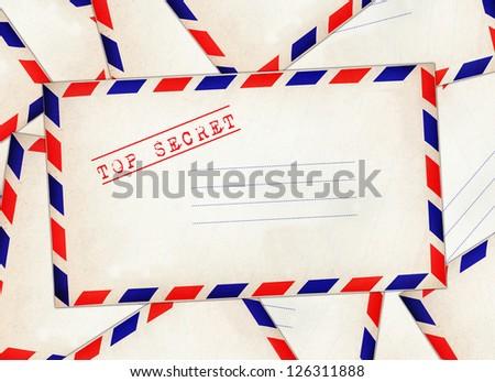 "White envelope stamp ""Top Secret"" on pile of envelopes. - stock photo"