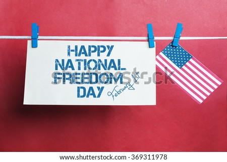 White envelope, USA flag hanging on colorful pegs ( clothespin ) on a line against red background. United States of America Concept text - National Freedom Day 1st of February.