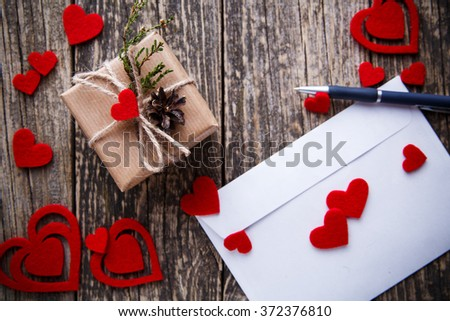 White envelope with red hearts for valentine's day.