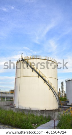 White ethanol, alcohol, the background of the blue sky white cloud of industrial storage tank of petrol and petroleum