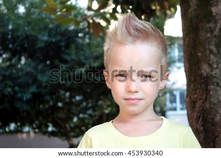 White european young serious boy and looking directly at the camera - stock photo