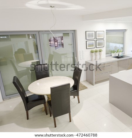 White exclusive kitchen with small dining space