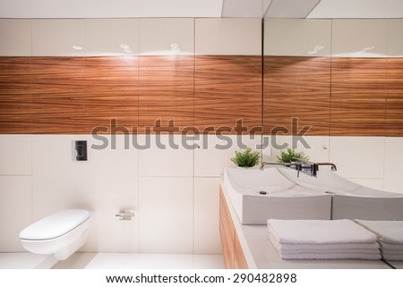 White exclusive small restroom with fancy basin - stock photo