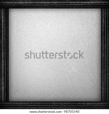 white fabric background with leather frame
