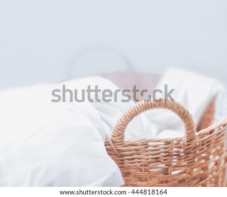 white fabric in the basket