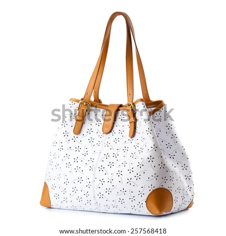 White female handbag with brown handles isolated on white. - stock photo
