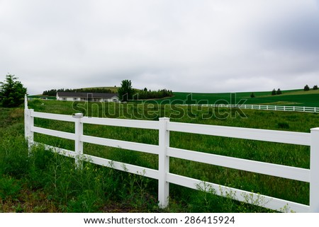 White fences with cloud storm in the rural Palouse, Whitman County, Washington State, USA. - stock photo