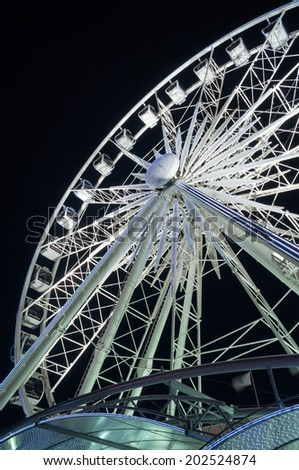White ferris wheel at an entertainment theme park in the Cape Town Waterfront, South Africa - stock photo