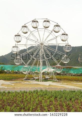 white ferris wheel in the park - stock photo