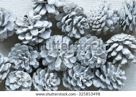 White Fir Cones On Wooden Background With Copy Space Or Your Text Here .Vintage, Retro Style Used As Winter Or Christmas Background. Close Up View. Christmas Card For Seasons Greetings - stock photo