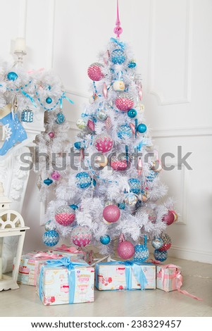 White fir-tree with pink and blue Christmas toys