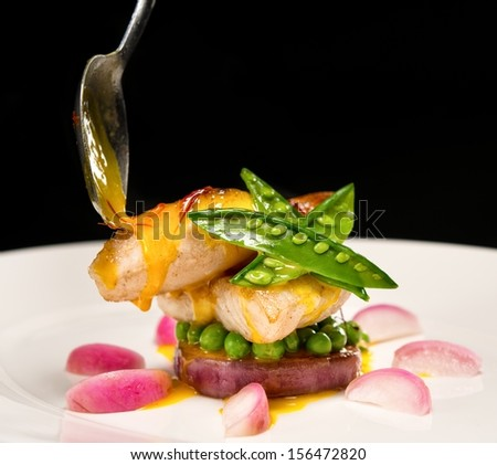 White fish fillet in sauce with radish and pies  - stock photo