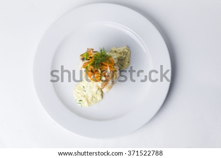 white fish with mashed potatoes and gravy, vegetables, onion dill carrot on a plate for restaurant menu isolated on a white background - stock photo