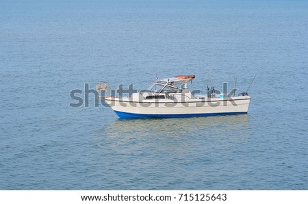 white fishing boat in the sea