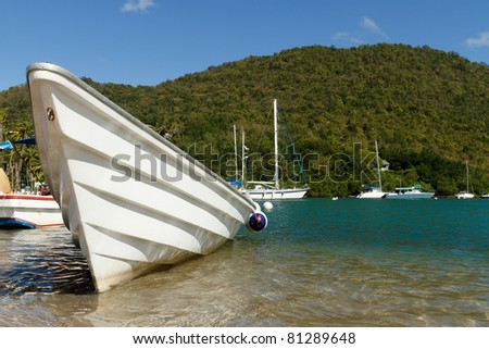White fishing boat on Marigot Bay in the Caribbean island of St Lucia - stock photo