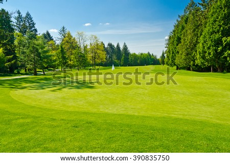 White flag at the beautiful golf course. - stock photo