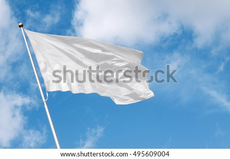 White flag waving in the wind against cloudy sky. Perfect mockup to add any logo, symbol or sign