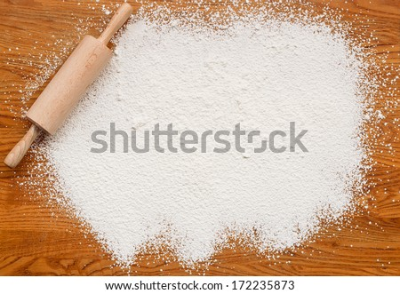 White flour on a wooden table creating a text area for insertion of your custom message or recipe