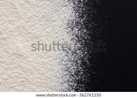 white flour on black background - free space for text - stock photo