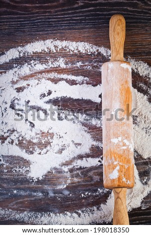 white flour on wooden table - stock photo