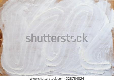 white flour on wooden table - stock photo