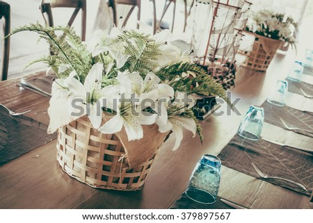 White flower in vase decoration on dining table - Vintage Filter
