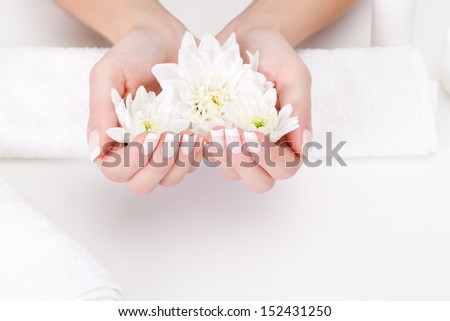 white flower with hands on white background - stock photo