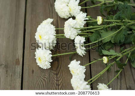 white flowers, bouquet on wooden
