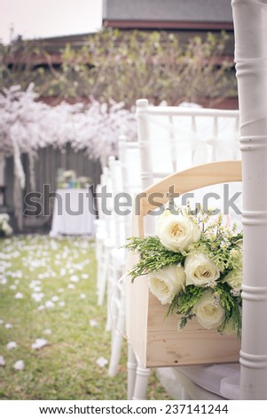 White flowers in a basket on a chair in his brother's wedding in December 2, 2014.