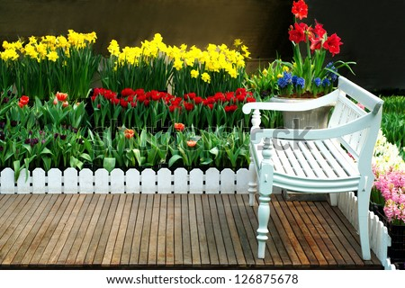 White flowers in a garden chair green,view nature tranquil landscape tree summer relaxation bush flower grass plant garden day outdoor lush foliage table lawn seat furniture comfortable front - stock photo