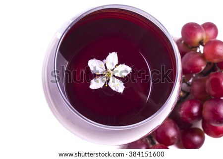 White flowers of cherry in a glass of wine - stock photo