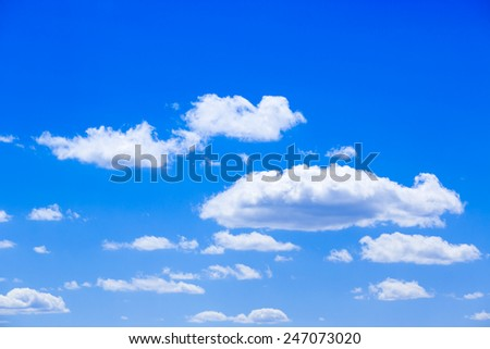 White fluffy clouds in the blue sky - stock photo