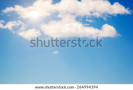 White fluffy clouds in the blue sky. Beauty world.