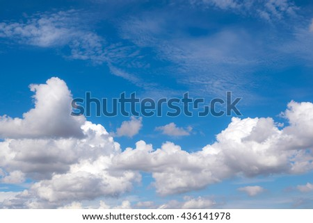 white fluffy clouds in the blue sky for background or backgrop nature concept - stock photo