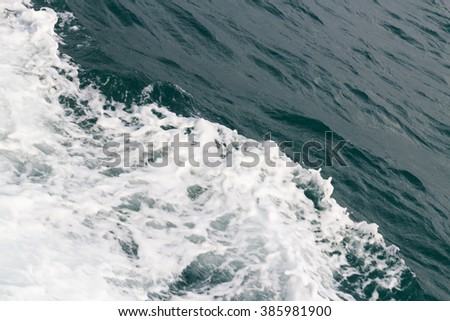 White foam on a sea water surface - stock photo