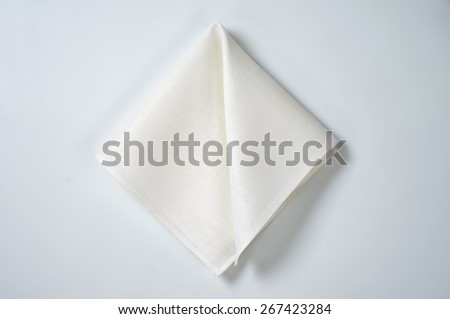 white folded napkin on white background