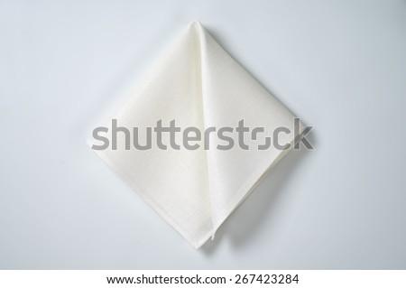 white folded napkin on white background - stock photo