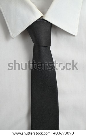 White formal shirt with black tie. Fashion and executive attire