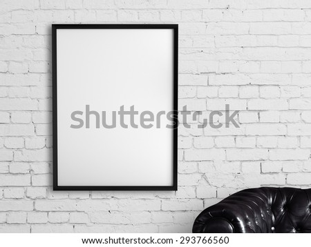 white frame hanging on a brick wall - stock photo