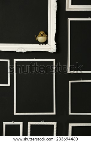 White frames over black wall, White vintage frames on the black wall - stock photo