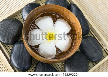 White Frangipani, hot and cold stone on bamboo mat - stock photo
