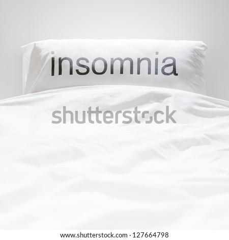 White fresh linen nobody, insomnia sign on pillow - stock photo
