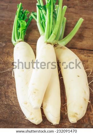 white fresh radishes on wood table  in market - stock photo