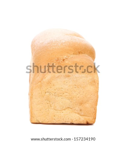 White fresh wheat bread. Close up.  Isolated on a white background.