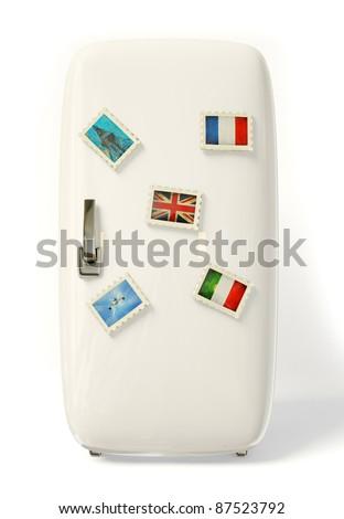 white fridge vith a colorful travel stickers. - stock photo
