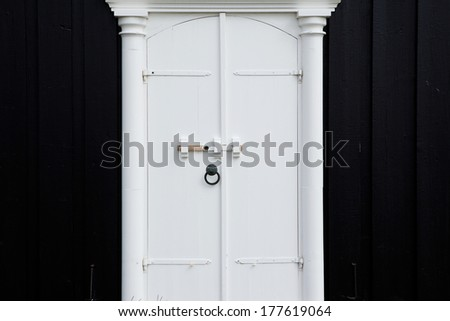 White front door of Budir Black Church, Snaefellsnes Peninsula, Western Iceland