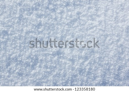 White frost snow toned in blue background - stock photo