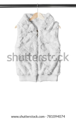 White fur sleeveless vest on wooden clothes rack isolated over white