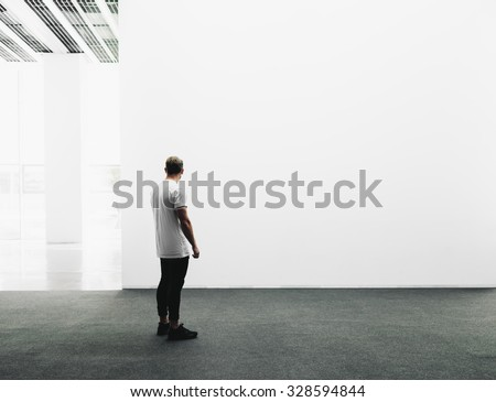 White gallery interior with empty and white canvas. - stock photo